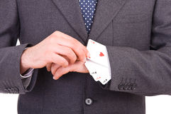 Businessman with playing cards hidden under sleeve. Business man with playing cards hidden under sleeve Royalty Free Stock Photography