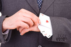 Businessman with playing cards hidden under sleeve. Business man with playing cards hidden under sleeve Stock Image