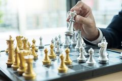 Businessman playing chess figure take a checkmate another king with team, strategy or management win or success concept royalty free stock photos