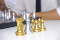 Businessman playing chess game; for business strategy, leadership and management concept stock photography