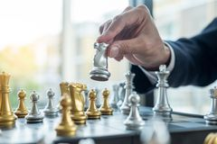Businessman playing chess game figures on wooden table for analysis new strategy plan, competition leader and teamwork concept for. Success stock images