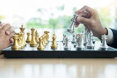 Businessman playing chess game figures on wooden table for analysis new strategy plan, competition leader and teamwork concept for. Success stock photography