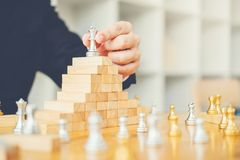 Businessman playing chess game Planning of leading strategy succ royalty free stock images
