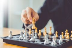 Businessman playing chess game Planning of leading strategy successful business leader concept.  royalty free stock images