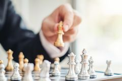 Businessman playing chess game Planning of leading strategy successful business leader concept.  stock image