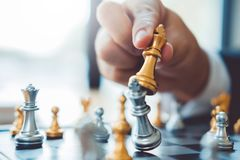 Businessman playing chess game Planning of leading strategy successful business leader concept.  stock photography