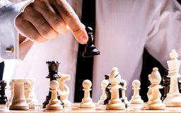 Businessman playing chess Royalty Free Stock Images