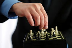 Businessman playing chess Stock Images