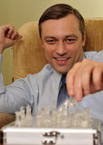 Businessman playing chess in the office Royalty Free Stock Photo