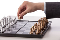 Businessman playing chess Stock Photo