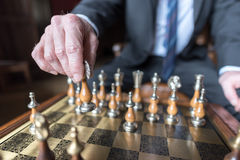 Businessman playing chess Royalty Free Stock Photos