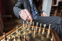 Businessman playing chess Stock Photography