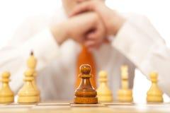 Businessman playing chess Stock Photo