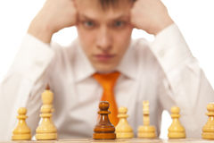 Businessman playing chess Royalty Free Stock Image