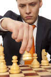 Businessman playing chess Stock Image
