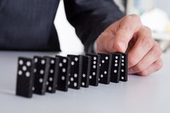 Businessman playing domino Stock Image