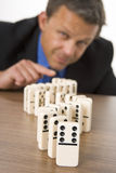 Businessman Playing Dominoes Royalty Free Stock Photography