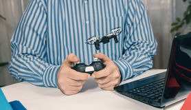 Businessman playing with drone toy to Relieve Stress at Work. Stock Photography