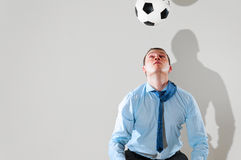 Businessman is playing football Royalty Free Stock Images
