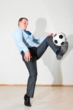Businessman is playing football Royalty Free Stock Photography