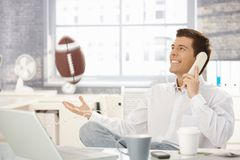 Businessman playing with football in office Royalty Free Stock Photos