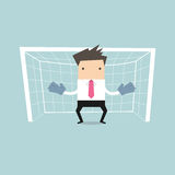 Businessman playing goalkeeper standing in front of goal Royalty Free Stock Photos