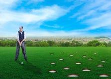 Businessman playing golf Royalty Free Stock Image