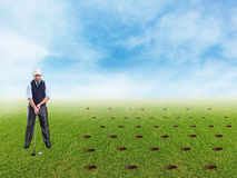 Businessman playing golf Royalty Free Stock Photo