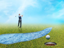 Businessman playing golf Stock Photography