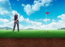 Businessman playing golf Royalty Free Stock Photos