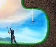 Businessman playing golf Royalty Free Stock Photos