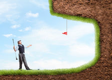 Businessman playing golf Stock Image