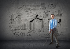 Businessman playing golf Stock Images