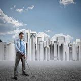 Businessman playing golf Stock Image
