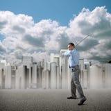 Businessman playing golf Stock Photos