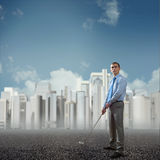 Businessman playing golf Royalty Free Stock Image