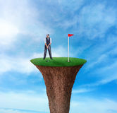Businessman playing golf Royalty Free Stock Photography