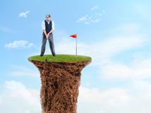 Businessman playing golf Royalty Free Stock Images