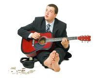 Businessman playing guitar Stock Images