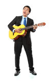 Businessman playing guitar Royalty Free Stock Photography
