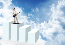 Businessman playing guitar Stock Images
