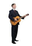 Businessman playing guitar Stock Image
