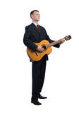 Businessman playing guitar Stock Photo