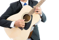 Businessman playing guitar isolate Stock Photography