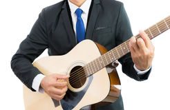 Businessman playing guitar isolate Royalty Free Stock Photography