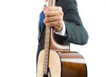 Businessman playing guitar isolate Stock Photo