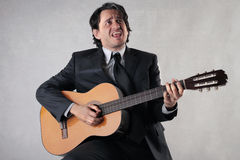 Businessman playing the guitar Royalty Free Stock Photo