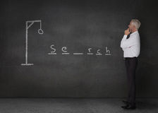 Businessman playing at hangman game Stock Photography