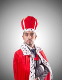 Businessman playing king isolated on white Stock Photography