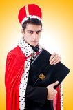 Businessman playing king Stock Images